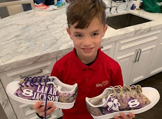 Baylen Robert Brees showing his painting on shoes
