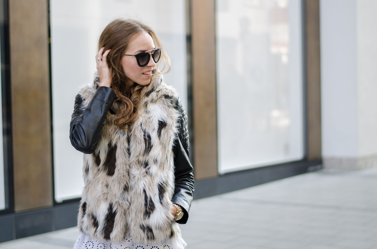 kristjaana mere zara faux fur vest barneys leather jacket prada cinema sunglasses