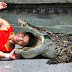 Watch Crazy Man Puts His Head Inside Crocodile's Mouth