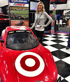 Katelyn Sweet posing for picture with a racing car