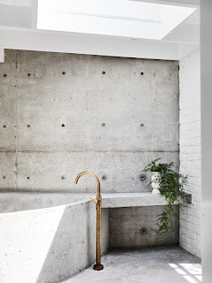 minimalist concrete bathroom with skylight