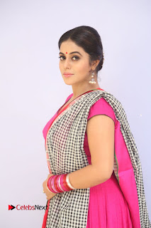 Actress Poorna Pictures in Red Salwar Kameez at Jayammu Nischayammu Raa Teaser Launch 0006