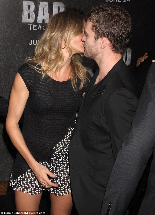 Remember me? Cameron Diaz, in an itty bitty mini-dress, greets ex Justin Timberlake with a kiss on the red carpet
