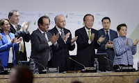 This file photo taken on December 12, 2015 shows French Ecology Minister Segolene Royal (L), French President Francois Hollande (2ndL), French Foreign Minister Laurent Fabius (C) and United Nations Secretary General Ban Ki-moon (2ndR) applauding after a statement at the COP21 Climate Conference in Le Bourget, north of Paris. Some scientists worry that the agreement focused on short-term climate change. (Photograph Credit: Miguel Medina/AFP/Getty Images) Click to Enlarge.
