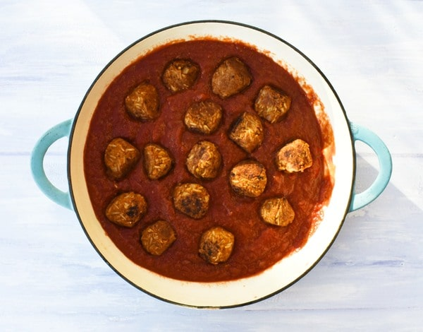 Step 11 - marinara sauce added to pan with meatballs