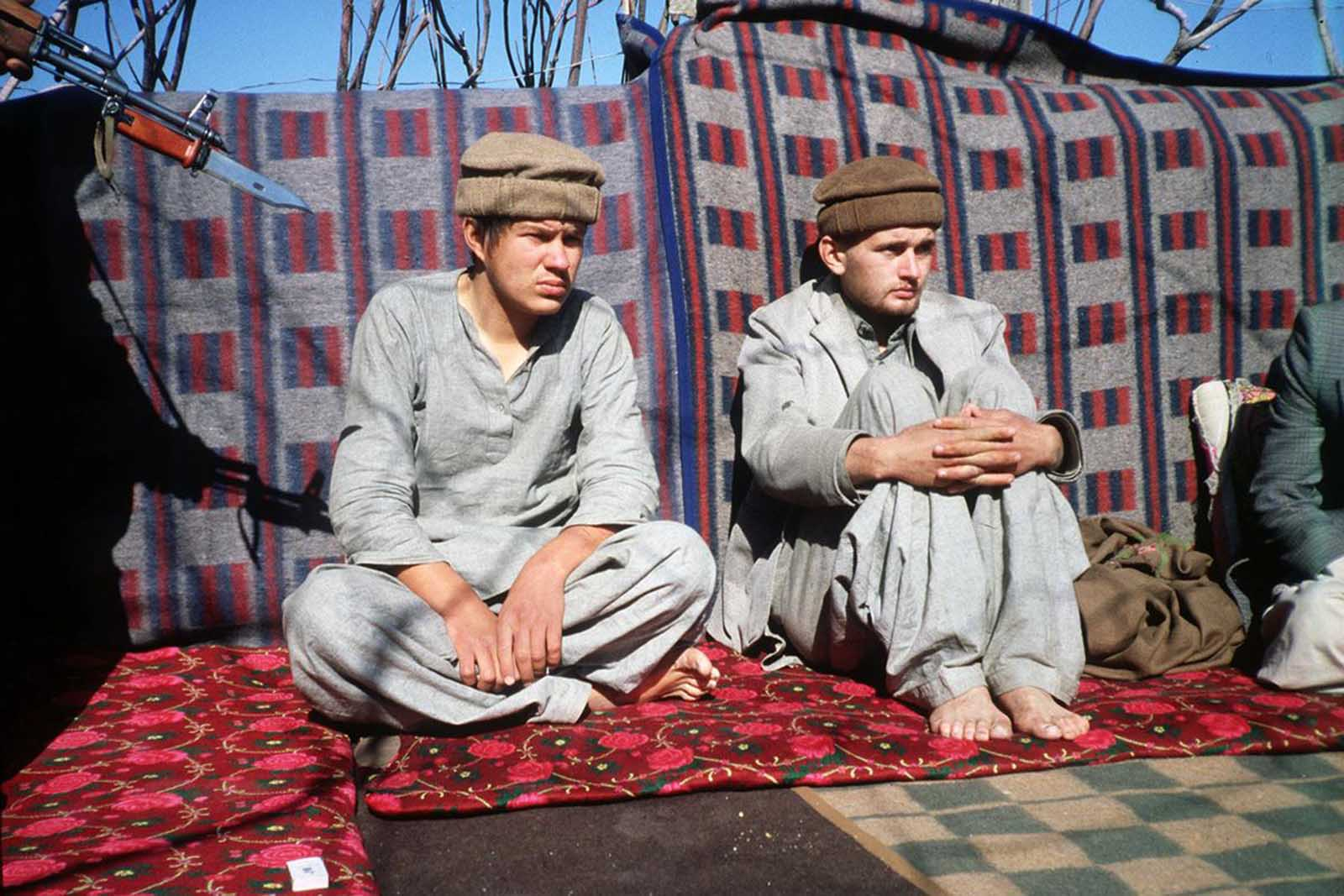 Two Soviet soldiers taken prisoner by the Afghan resistance forces loyal to the fundamentalist faction of Hezb-i-Islami in the Afghan province of Zabul in September of 1981. The prisoners had told journalists then they would be executed by the Afghan resistance for refusing to covert to Islam to make eligible to be tried by an Islamic court.