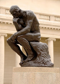 A bronze statue of Socrates shows him sitting and pondering for he always said that the unexamined life was not worth living.