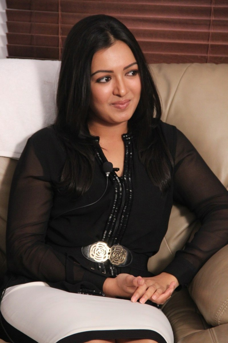 Catherine Tresa Stills In Black Dress