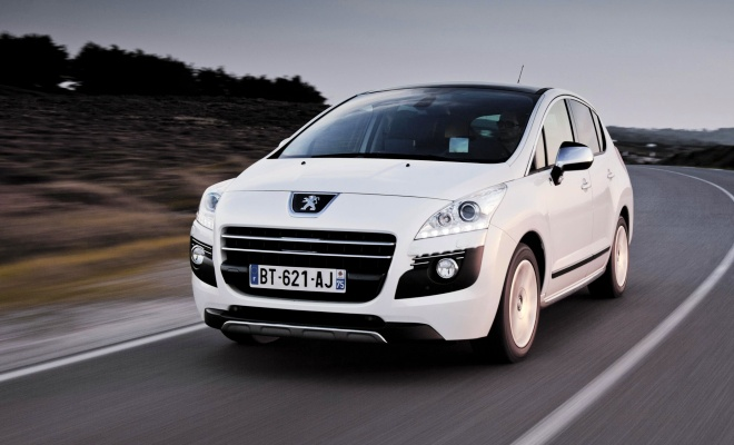 Peugeot 3008 Hybrid4 driving on a country road