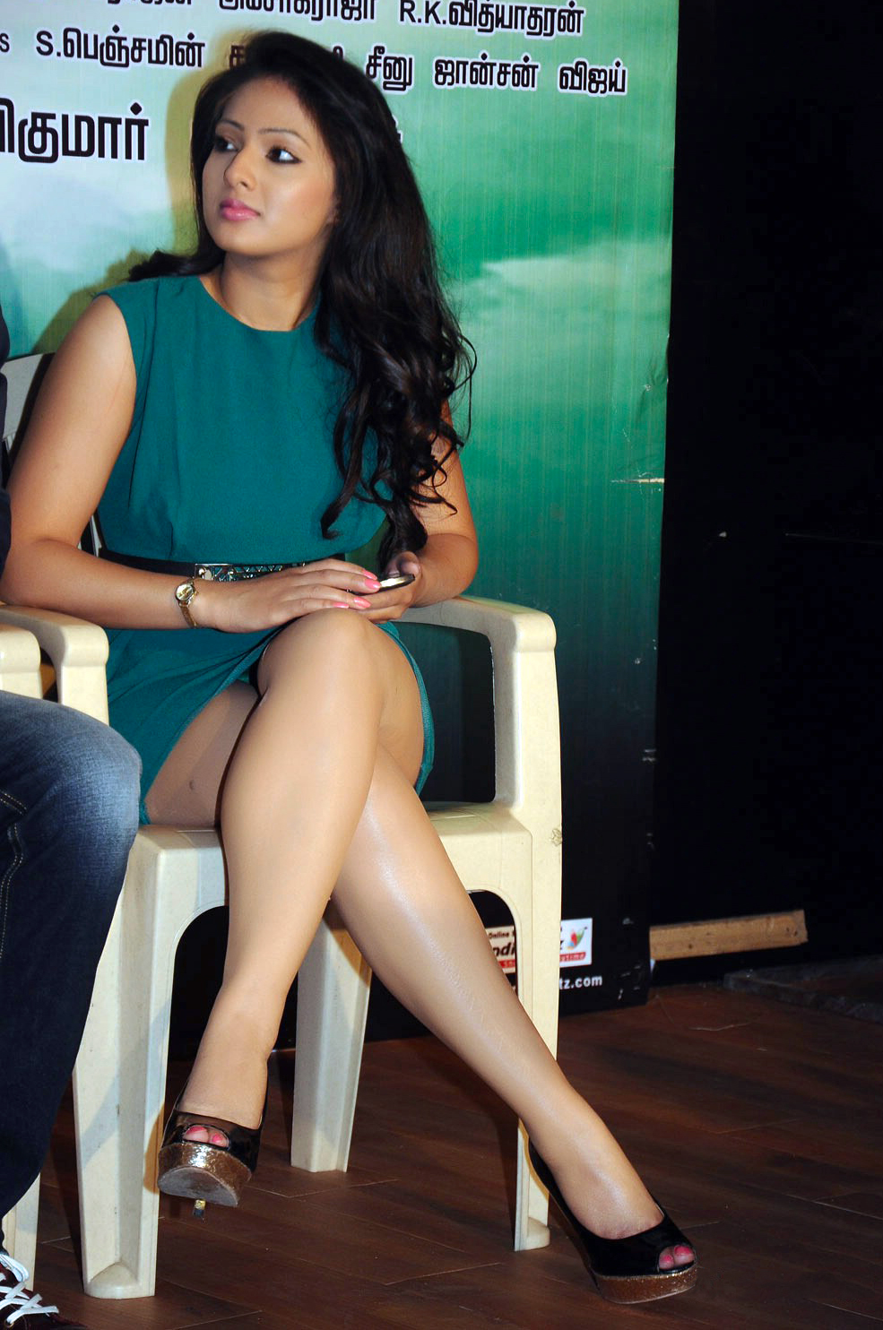 Nikesha Patel Sitting Crossed Legs Short Dress Glossy Legs