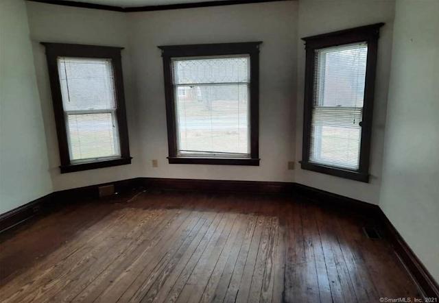 unpainted woodwork and flooring in living room of Sears Avoca in East Hampton CT