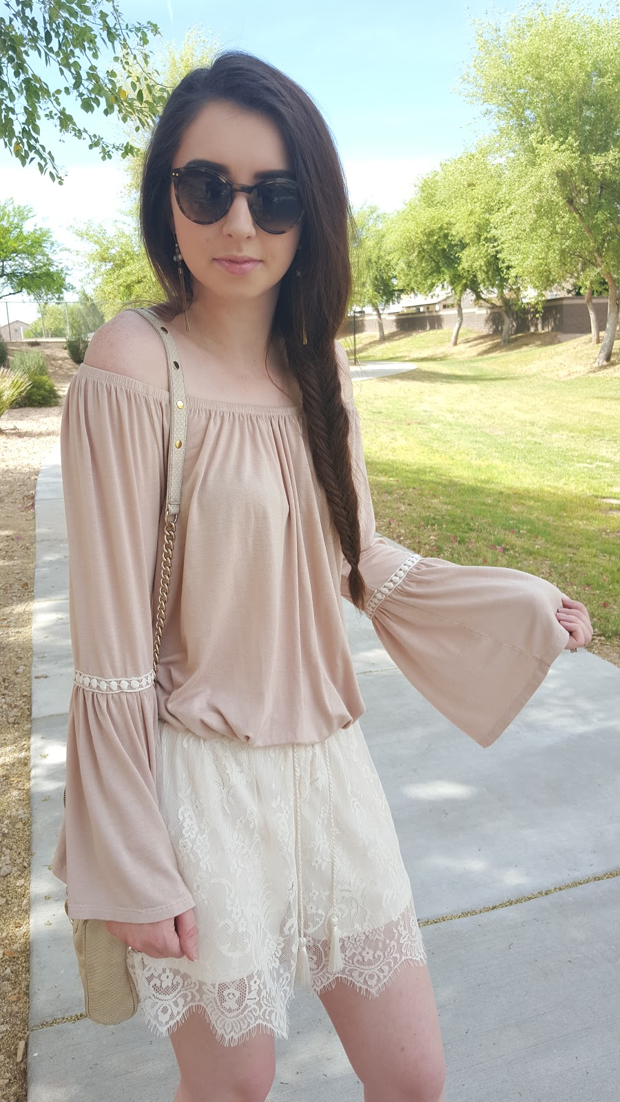 pretty boho outfit with bell sleeve top, fish tail braid, and lace shorts