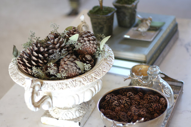 styling a coffee table fall christmas pinecones antique urn 2
