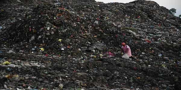 A woman on a dumping area