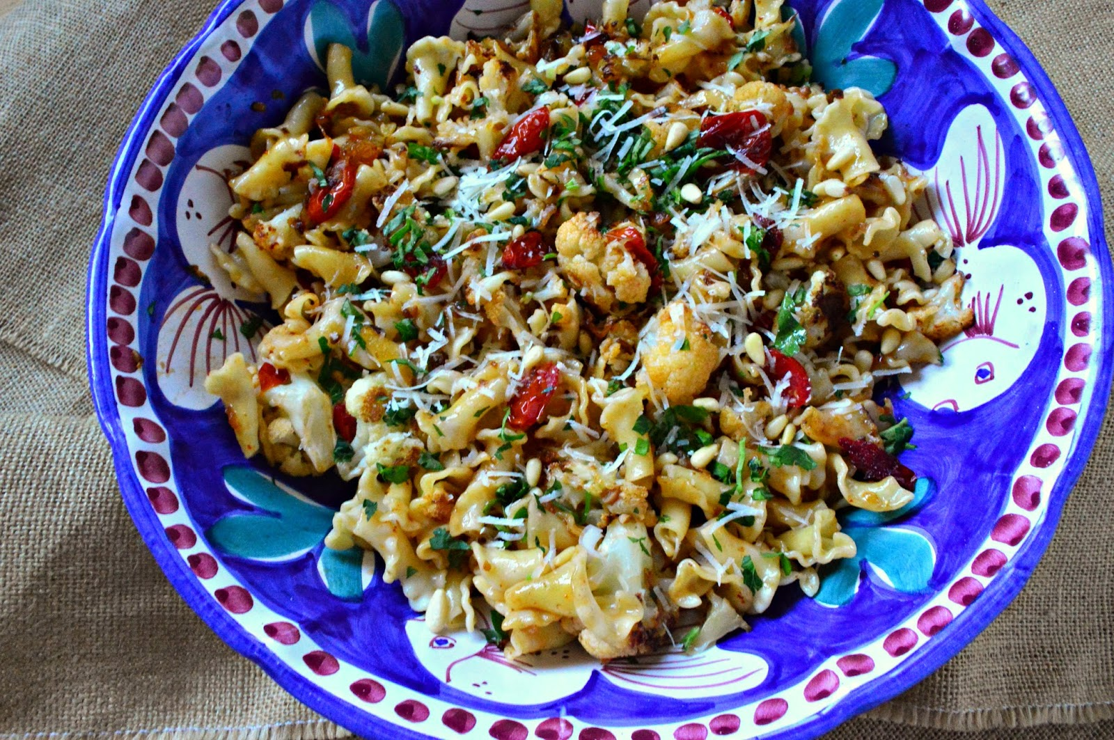 Pasta with Roasted Cauliflower, Raisins, Pine Nuts and Anchovies is a delicious pasta dish with lots of salty and sweet addictive flavors going on! You will love it! #cauliflower #pasta www.thisishowicook.com