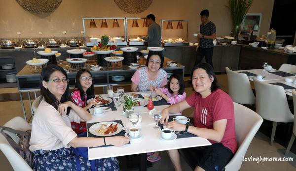 Seda Atria breastfast buffet - waiter - Bacolod blogger - Bacolod mommy blogger - bacon for breakfast - family travel - Iloilo City - Misto - ninang