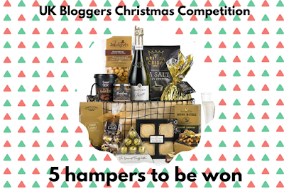 A hamper display of Christmas-themed food products