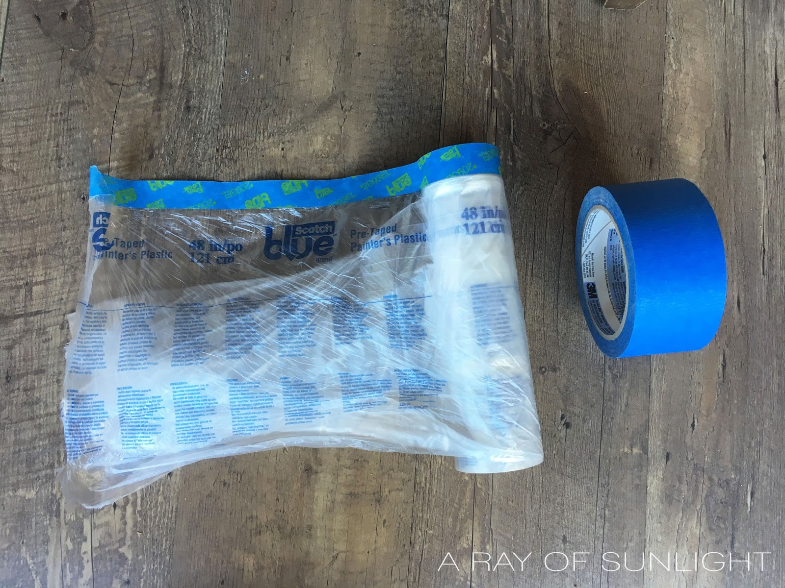 How to prep furniture for paint by taping off your furniture for a paint sprayer. This is the best way to spray your furniture without getting overspray inside the drawers and cabinet spaces. How to Use a Paint Sprayer on Furniture by A Ray of Sunlight