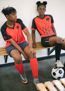 young soccer players on bench