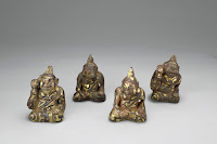 Set of mat weights in the shape of figures listening to music, unearthed from Tomb 1, Dayun Mountain, Xuyi, Jiangsu. Western Han period (206 BCE–9 CE), 2nd century BCE. Bronze inlaid with gold and silver. Nanjing Museum [Credit: © Nanjing Museum]
