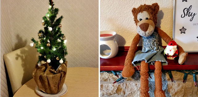 A mini decorated Christmas tree and a stuffed Monkey toy.