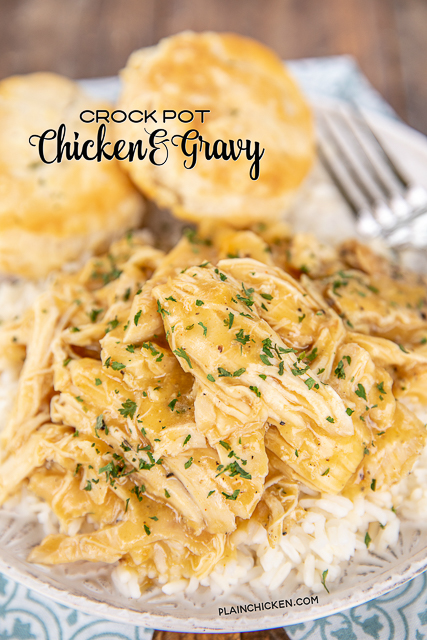 chicken and gravy over rice on a plate