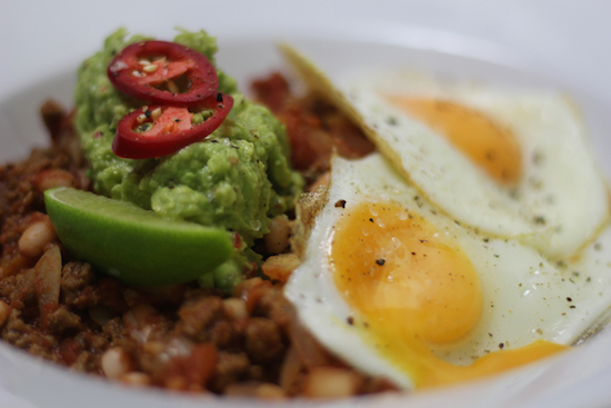 Veggie chilli with guacamole and eggs