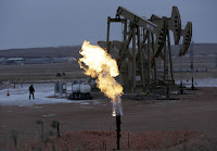 Pumpjack and flaring (Credit: AP Photo/Eric Gay, File) Click to Enlarge.