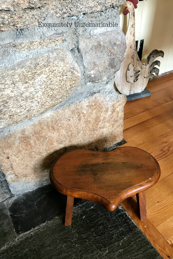 Wooden Heart Stool next to fireplace