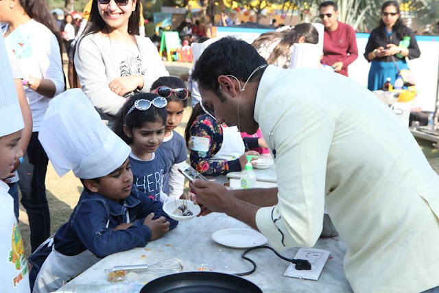 Chef Saransh Goila in action with the kids at Kids Culinare