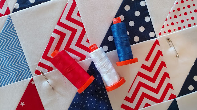 Red, white, and blue half square triangle (HST) quilt