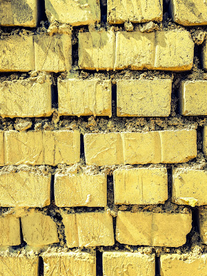 A Minimalist Photo of brick of yellow all in repetition shot by Samsung Galaxy S6 Smart Phone