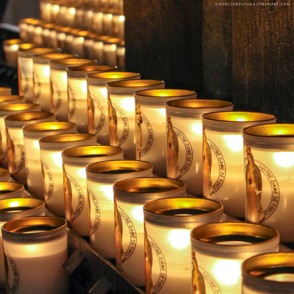 Inside Notre Dame Cathedral in Paris lit candles for prayer