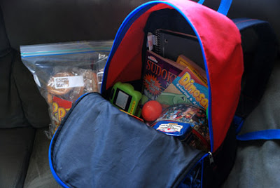 backpack filled with toys to keep kids entertained