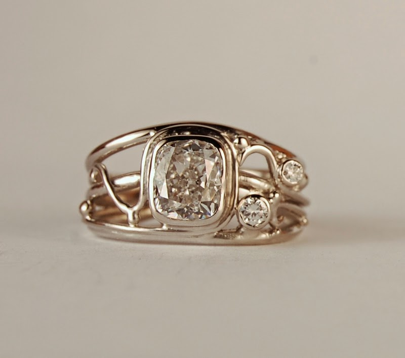 Open wire work ring with a rectangular 1.30 ct. diamond and two side diamonds