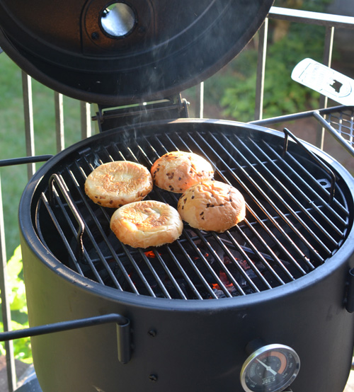 Toasting buns on the Oklahoma Joe's Bronco drum smoker.