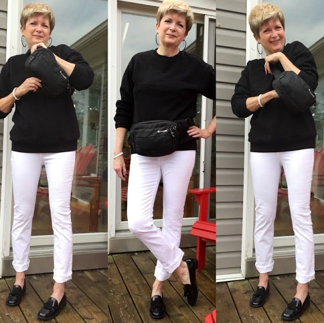 three shots of a women in black top, white jeans, black loafers wearing a black belly pack and then trying to get it over her head