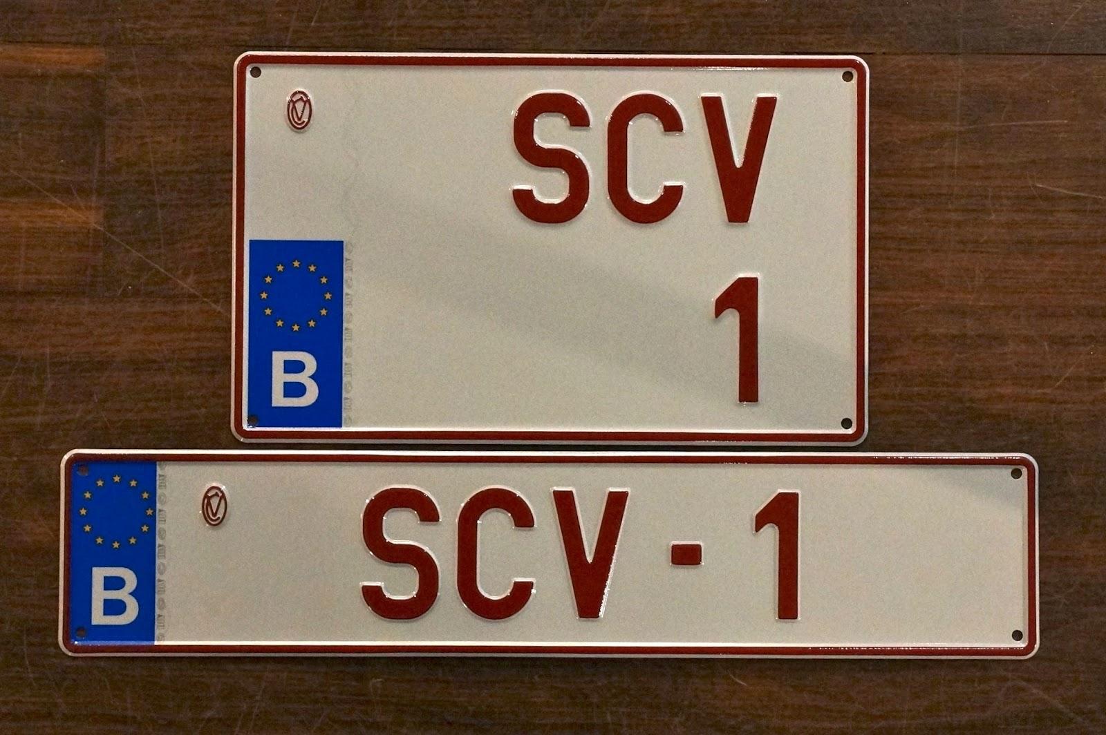 witte nummerplaat met of zonder nl