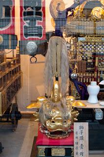 Festive gold lion mask belonging to the Kayabasho 1-chome neighborhood.