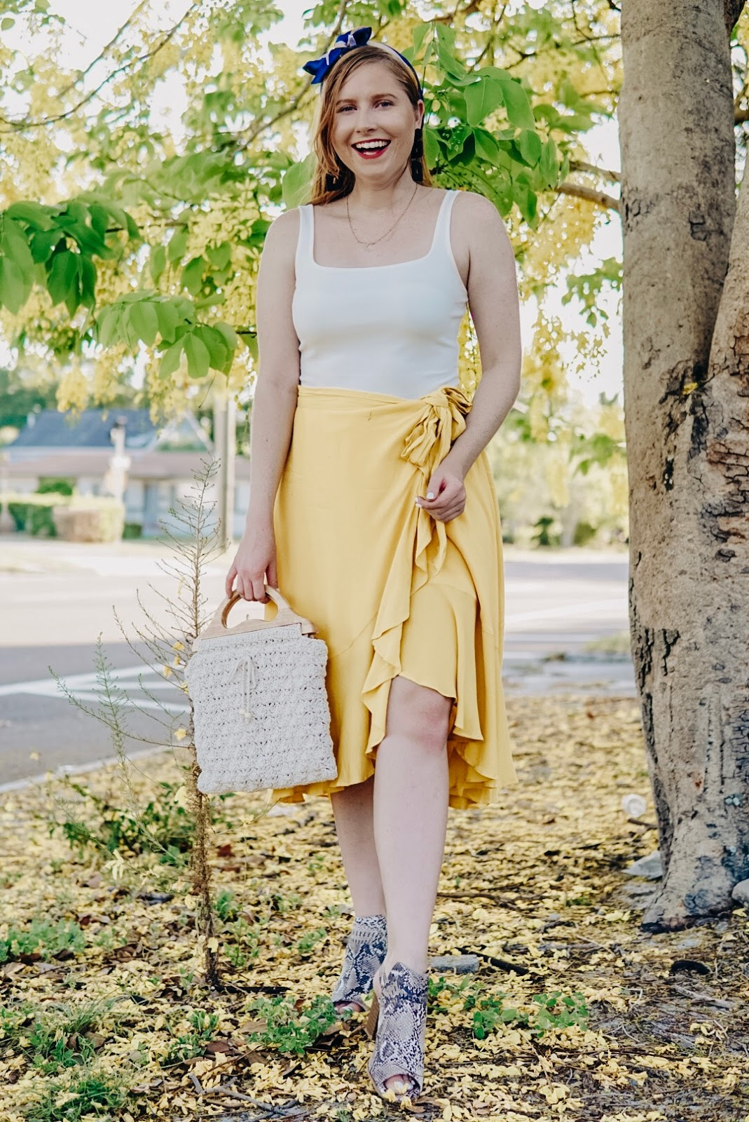 Styling a Casual Yellow Wrap Midi Skirt for Summer | Affordable by Amanda by Amanda Burrows, she is a Tampa Blogger wearing a yellow ruffle midi skirt from Misred Outfitters