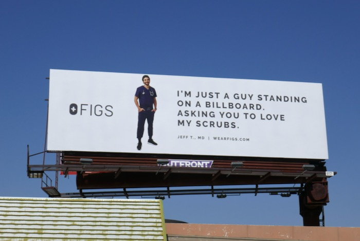 just a guy standing on a billboard love figs scrubs