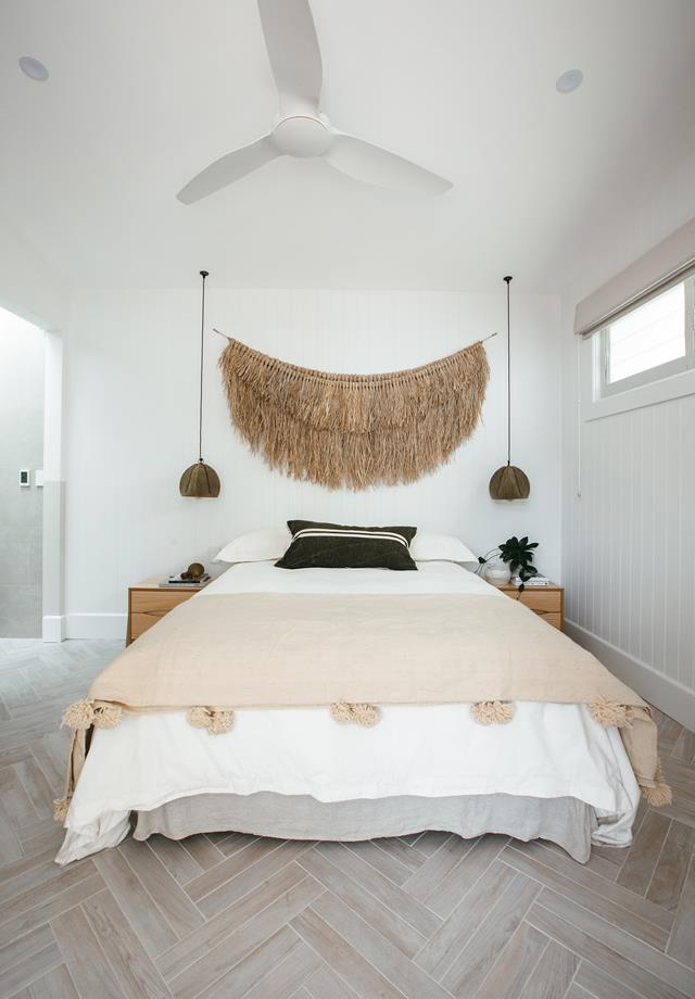 The guest bedroom with a statement woven wall hanging