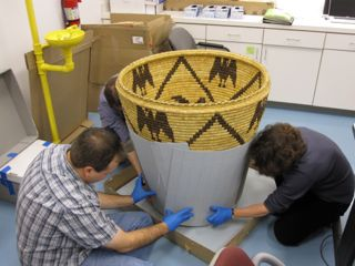 Art conservators working on historic Native American Basket, collection care, archival support