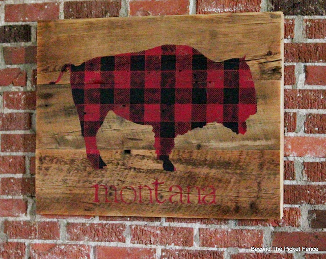 a rustic sign painted on old barn wood perfect for a cabin