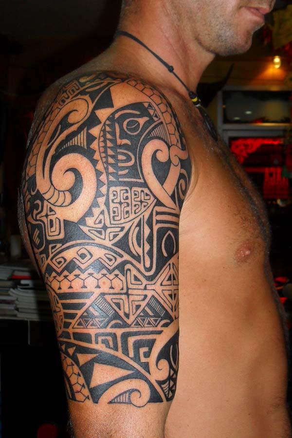 half seelve polynesian tattoo