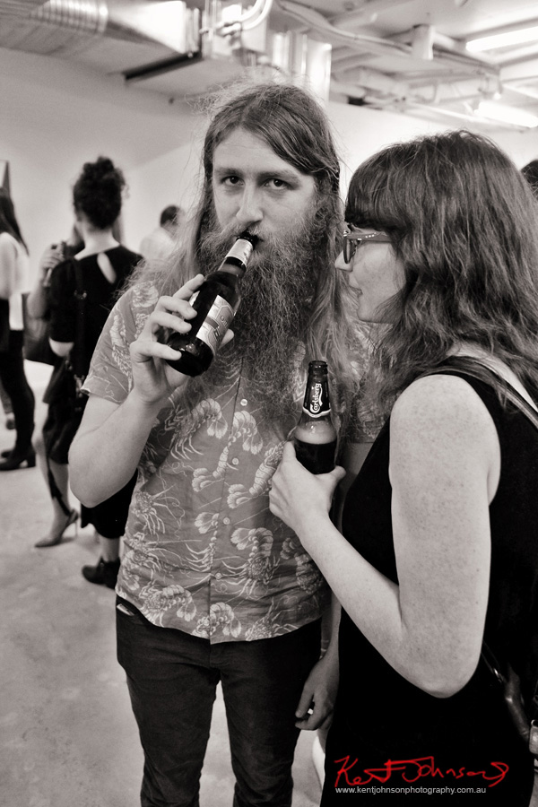 A couple drinking beer. COMA Gallery & Art Opening - Photographed by Kent Johnson for Street Fashion Sydney.