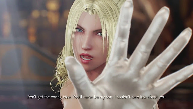 "Nina Williams is the woman wearing veil and wedding dress demonstrating a stop sign with her hand with subtitle: ""Don't get the wrong idea. You'll never be my son. I couldn't care less about you."""