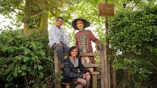 Worzel, Susan and John sitting at a style in a hedge