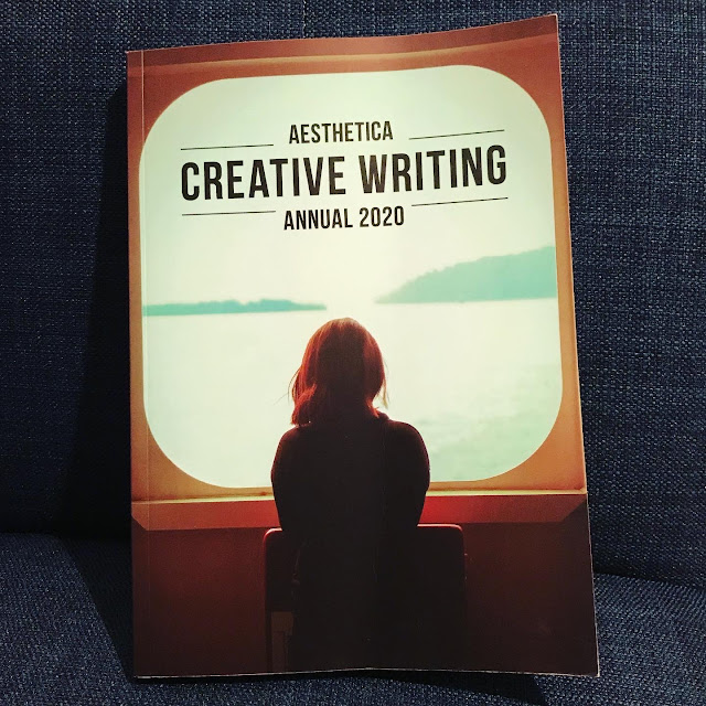 A book resting on a blue chair. The title is Aesthetica Creative Writing Annual 2020.