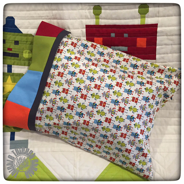 Robots All In A Row Coordinating Pillow by Thistle Thicket Studio. www.thistlethicketstudio.com